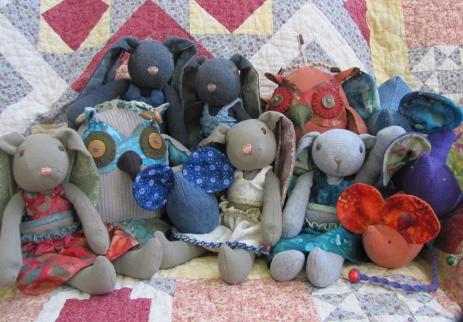 About a six year old photo of some of the recycled animal friends I've made over the years.  In the center is Sophie - my very first t-shirt bunny creation.