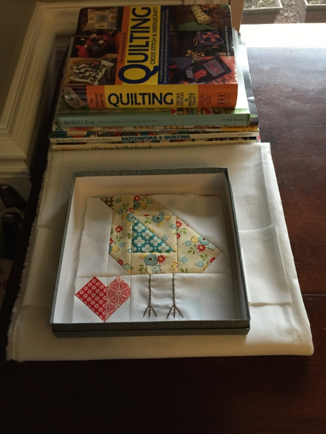 I tend to keep my most used books handy, along with whatever background fabric I'm using at the time as well.  The little box? Well, doesn't that just work perfectly for my little 6