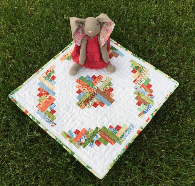 Even Sophie Bunny loves our new Chirp Chirp quilt!