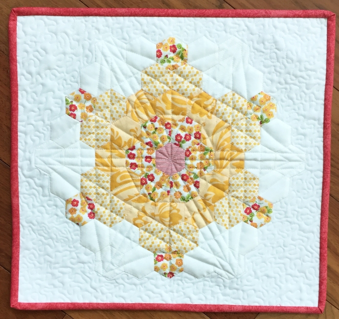 I call this one my Starburst Mini Quilt, and as you can see - it's a bit bigger than the snack mat...