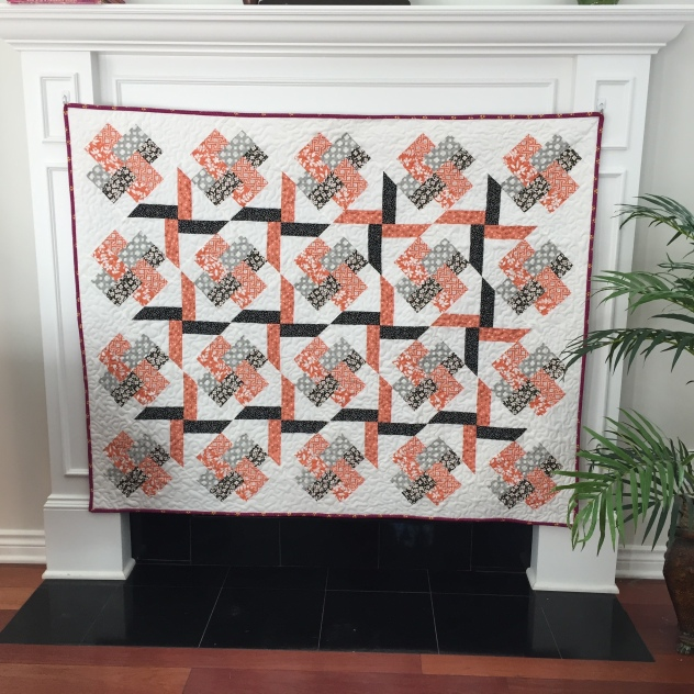 My Halloween Joy Quilt, made with fabrics from Moda's Farmhouse, Mixologie, Tiki Tok, Feed Company and Meadowbloom, Kona Snow for the Background and Backing, and topped off with Aurifil 2021 for the machine piecing and quilting.